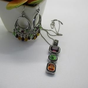 Lia sophia pendant with matching earrings.